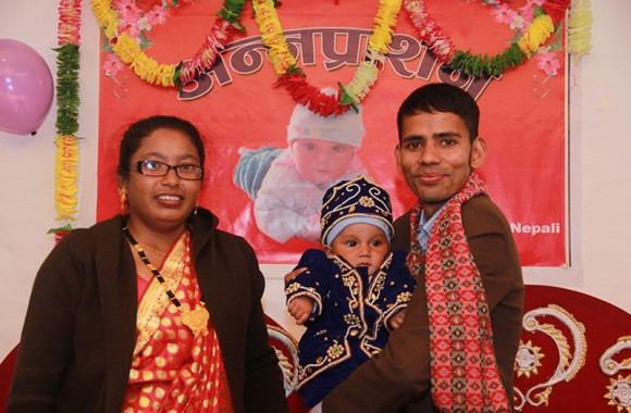 parents happy with their child weaning ceremony